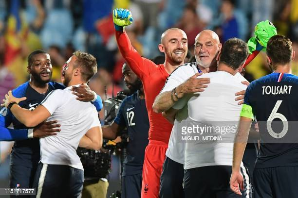 France's goalkeeper Paul Bernardoni celebrates after the Group C match of the U21 European Football Championships between France and Romania on June...
