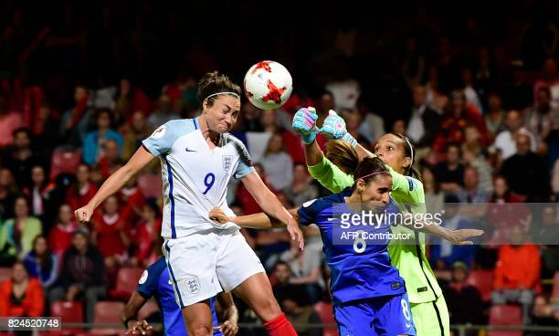 France's goalkeeper Sarah Bouhaddi saves a ball next to England's forward Jodie Taylor during the UEFA Women's Euro 2017 tournament quarterfinal...