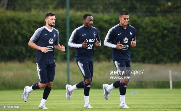France's goalkeeper Steve Mandanda France's goalkeaper Hugo Lloris and France's goalkeeper Alphonse Aerola run during a training session in...