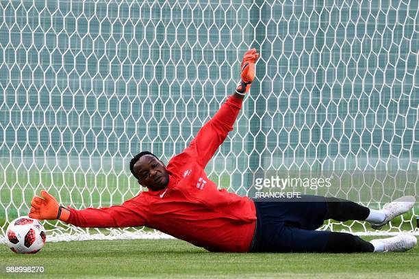 France's goalkeeper Steve Mandanda jumps for the ball during a training session at the Glebovets stadium in Istra some 70 km west of Moscow on July 1...
