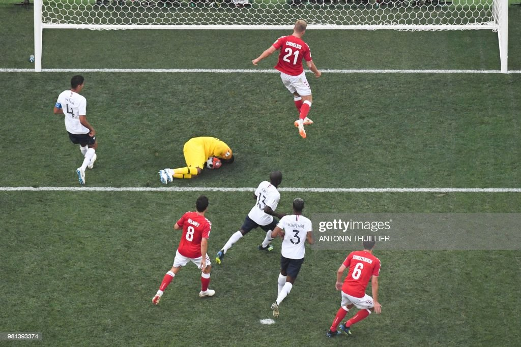 TOPSHOT - France's goalkeeper Steve Mandanda (C) saves a shot during the Russia 2018 World Cup Group C football match between Denmark and France at the Luzhniki Stadium in Moscow on June 26, 2018. (Photo by Antonin THUILLIER / AFP) / RESTRICTED