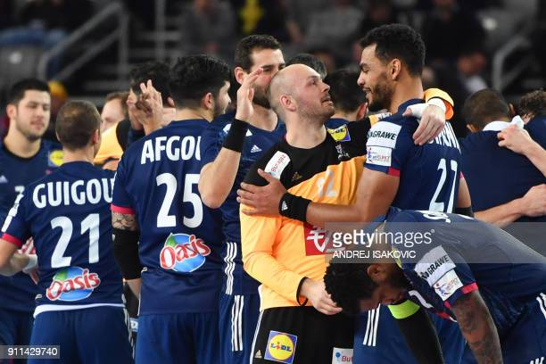France's goalkeeper Vincent Gerard France's Adrien Dipanda and teammates celebrate winning the match for third place of the Men's 2018 EHF European...