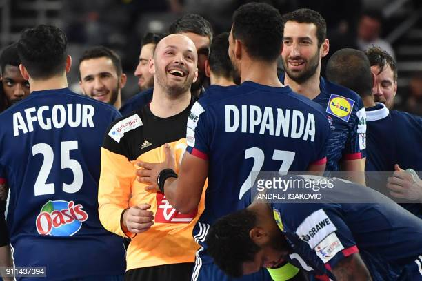 France's goalkeeper Vincent Gerard France's Adrien Dipanda France's Raphael Caucheteux and teammates celebrate winning the match for third place of...