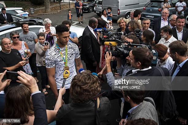 France's gold medalist in boxing at the 2016 Rio Olympics Tony Yoka speaks to journalist in his hometown ChantelouplesVignes on August 29 2016 / AFP...