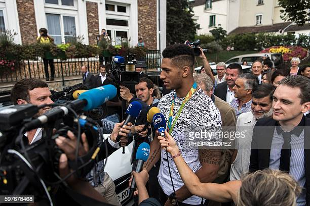 France's gold medalist in boxing at the 2016 Rio Olympics Tony Yoka speaks and poses for journalist in his hometown ChantelouplesVignes on August 29...