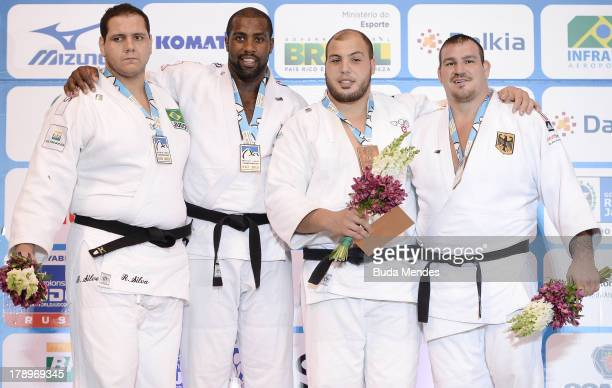France's gold medalist Teddy Riner Brazil's silver medalist Rafael Silva and bronze medalists Faicel Jaballah of Tunisia and Andreas Toelzer of...