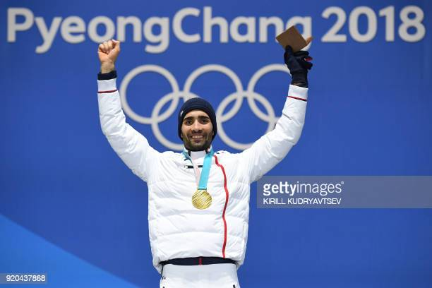 TOPSHOT France's gold medallist Martin Fourcade poses on the podium during the medal ceremony for the biathlon men's 15km Mass Start at the...