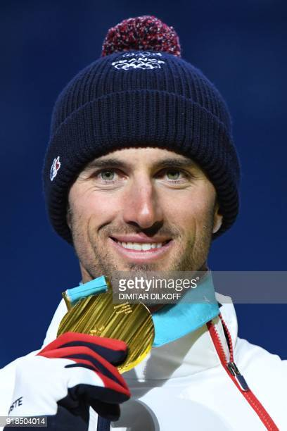 France's gold medallist Pierre Vaultier poses on the podium during the medal ceremony for the Men's Snowboard Cross at the Pyeongchang Medals Plaza...