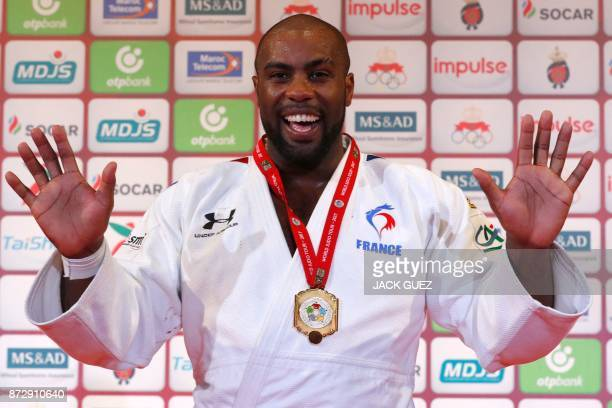 TOPSHOT France's gold medallist Teddy Riner gestures as he celebrates on the podium after defeating Belgium's Toma Nikiforov during the Judo World...