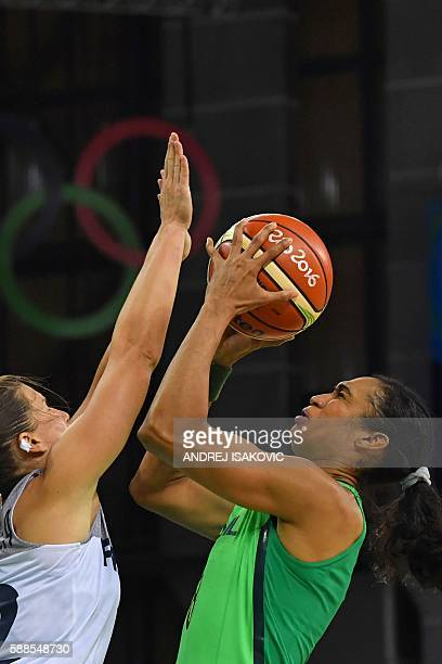 France's guard Gaelle Skrela defends against Brazil's shooting guard Iziane Castro during a Women's round Group A basketball match between France and...