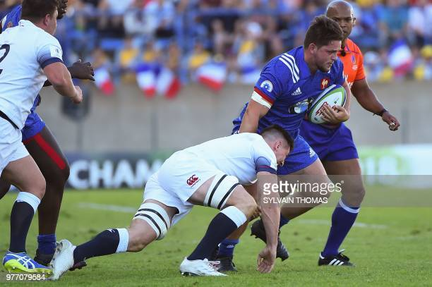 France's Guillaume Marchand vies with England's Ben Curry during the U20 World Rugby Union championship final match England vs France at the...