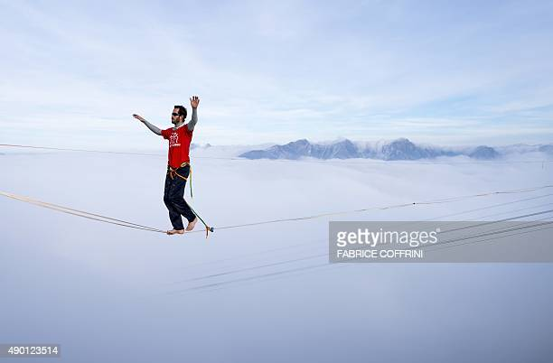 France's Guillaume Rolland walks on the line during the Highline Extreme event in Moleson peak western Switzerland on September 26 2015 Fifty of the...