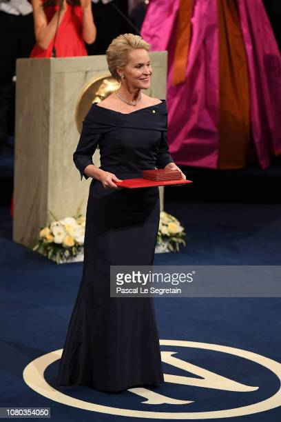 Frances H Arnold laureate of the Nobel Prize in Chemistry acknowledges applause after she received her Nobel Prize from King Carl XVI Gustaf of...