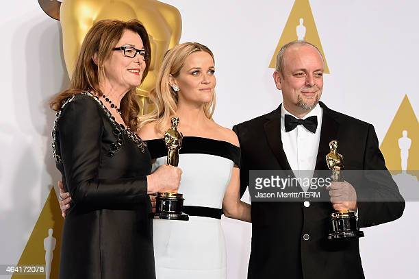 Frances Hannon actress Reese Witherspoon and Mark Coulier winner of the Best Makeup Hairstyling Award for 'The Grand Budapest Hotel' pose in the...