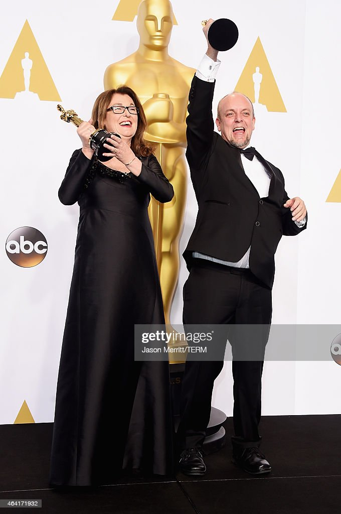 Frances Hannon (L) and Mark Coulier, winners of the Best Makeup & Hairstyling Award for 'The Grand Budapest Hotel' pose in the press room during the 87th Annual Academy Awards at Loews Hollywood Hotel on February 22, 2015 in Hollywood, California.