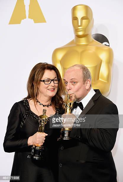 Frances Hannon and Mark Coulier, winners of the Best Makeup & Hairstyling Award for 'The Grand Budapest Hotel' pose in the press room during the 87th...