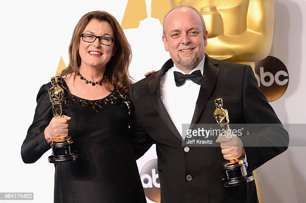 Frances Hannon and Mark Coulier with the award for best makeup and hairstyling for film The Grand Budapest Hotel pose in the press room during the...