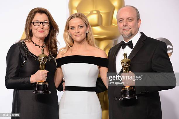 Frances Hannon and Mark Coulier with the award for best makeup and hairstyling for film The Grand Budapest Hotel with actress Reese Witherspoon pose...