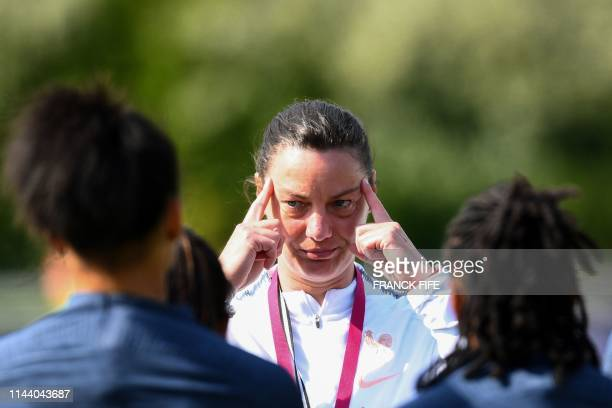 France's head coach Corinne Diacre reacts as she leads her team players in a training session in Clairefontaine-en-Yvelines on May 16 as part of the...