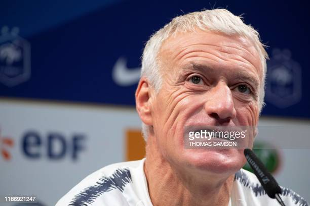 France's head coach Didier Deschamps addresses a press conference in Clairefontaine-en-Yvelines, near Paris, on September 9 a day ahead of the UEFA...