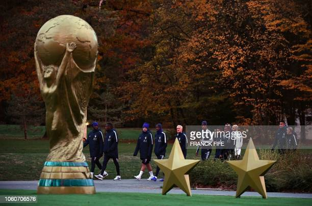 France's head coach Didier Deschamps arrives for a training session with his players in Clairefontaine-en-Yvelines on November 12 as the team...