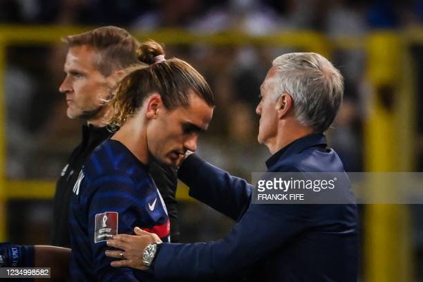 France's head coach Didier Deschamps congratulates France's forward Antoine Griezmann as he leaves the pitch during the FIFA World Cup Qatar 2022...