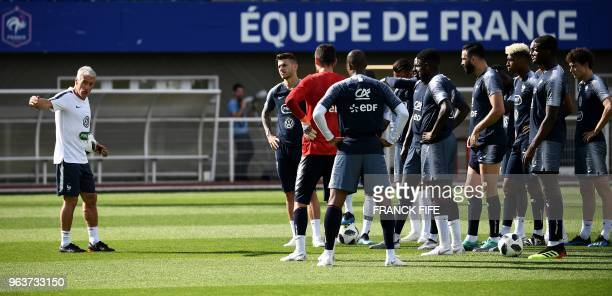 France's head coach Didier Deschamps gives instructions his players during a training session in Clairefontaine en Yvelines on May 30 as part of the...