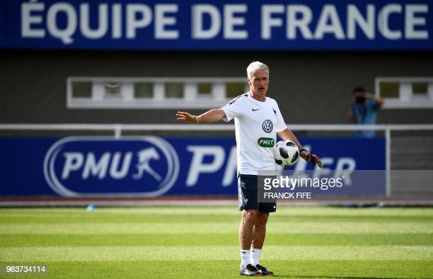 France's head coach Didier Deschamps gives instructions to players during a training session in Clairefontaine en Yvelines on May 30 as part of the...