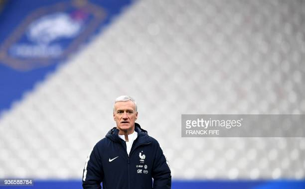 France's head coach Didier Deschamps looks on during a training session at the Stade de France in SaintDenis northern Paris on March 22 2018 on the...