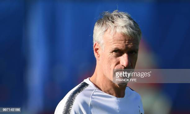 France's head coach Didier Deschamps looks on during a training session at the Glebovets stadium in Istra some 70 km west of Moscow on July 12 ahead...