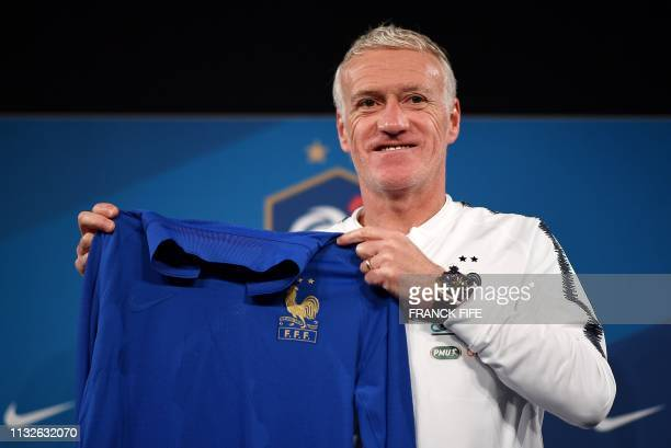 France's head coach Didier Deschamps presents the jersey of the French national team celebrating the 100th anniversary of the French federation...