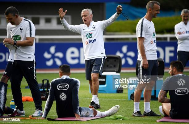 France's head coach Didier Deschamps reacts at the end of a training session in ClairefontaineenYvelines on June 4 as part of the team's preparation...