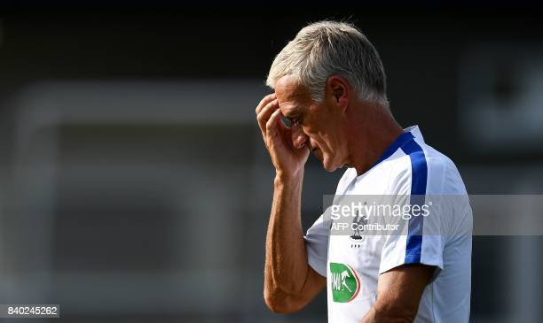France's head coach Didier Deschamps reacts during a training session in Clairefontaine en Yvelines on August 28 as part of the team's preparation...