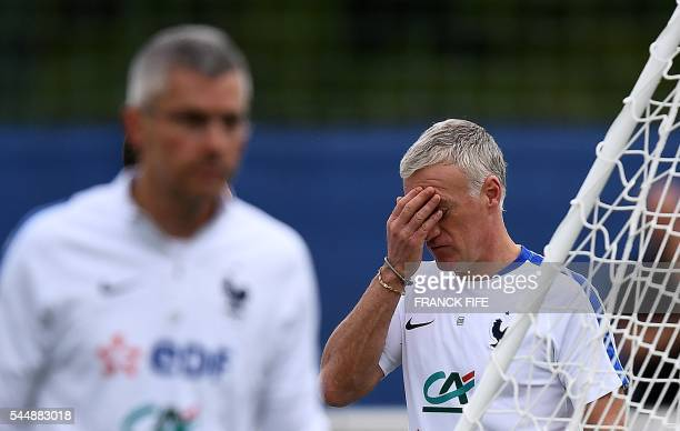 France's head coach Didier Deschamps reacts during a training sessiosn in Clairefontaine en Yvelines on July 4 during the Euro 2016 football...