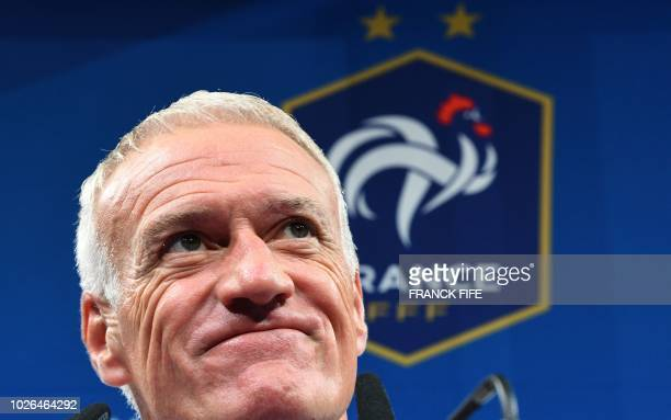 France's head coach Didier Deschamps smiles as he gives a press conference in Clairefontaine-en-Yvelines on September 3 as part of the France' team...
