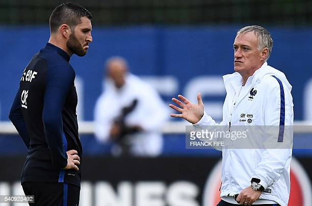 France's head coach Didier Deschamps speaks with France's forward AndrePierre Gignac during a training session in ClairefontaineenYvelines on June 17...