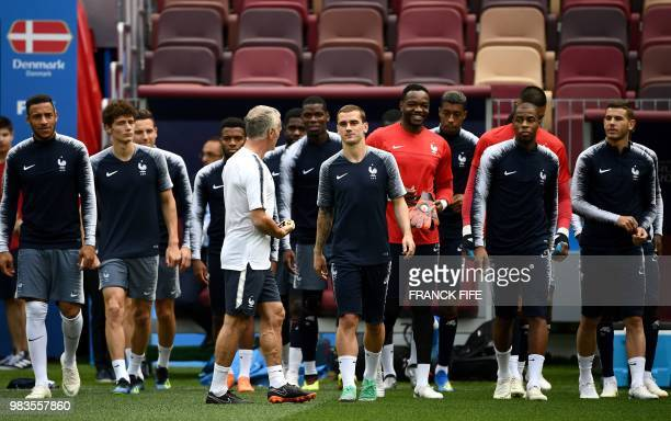 France's head coach Didier Deschamps speaks with France's forward Antoine Griezmann ahed of a training session of France national football team at...