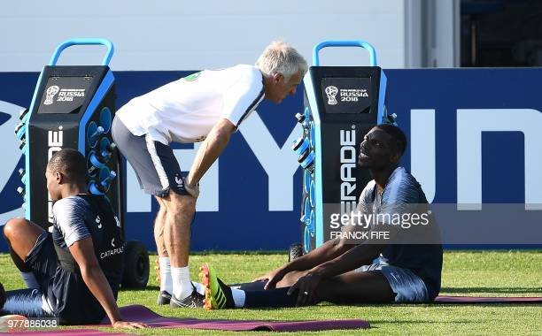 France's head coach Didier Deschamps speaks with France's midfielder Paul Pogba at the end of a training session at the Glebovets stadium in Istra...