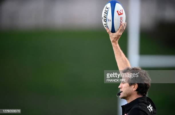 France's head coach Fabien Galthie speaks to his players during a training session on October 21 2020 in Marcoussis south of Paris as part of the...