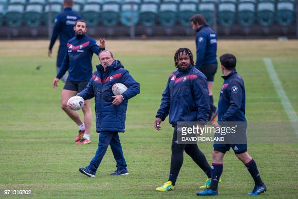France's head coach Jacques Brunel and captain Mathieu Bastareaud attend a training session prior to the second rugby test match against New Zealand...