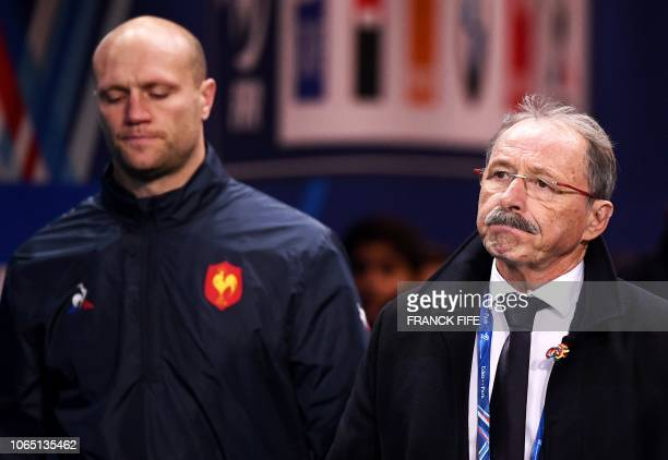 France's head coach Jacques Brunel walks with France's rugby union team lineout coach Julien Bonnaire as they arrive for the international rugby...