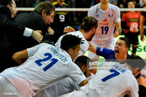 France´s head coach Laurent Tillie and his players celebrate after the Men's CEV Tokyo Volleyball European Qualification 2020 final match France vs...