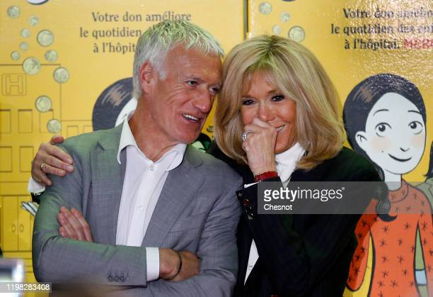 France's head coach of the French national football team Didier Deschamps speaks with French President's wife Brigitte Macron during the launch of...