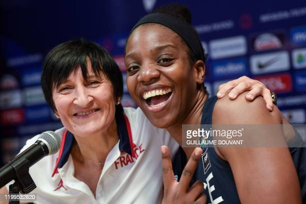 France's headcoach Valerie Garnier and France's wing Endene Miyem poses after their win against Brazil in the FIBA Women's Olympic Qualifying...
