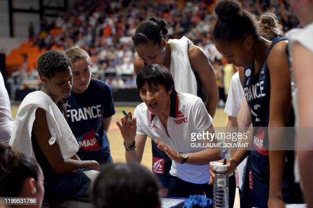 France's headcoach Valerie Garnier talks to her players during the FIBA Women's Olympic Qualifying Tournament match between France and Brazil on...