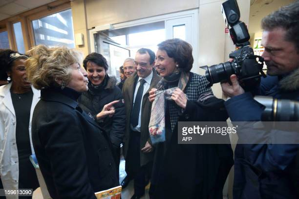 France's Health minister Marisol Touraine jokes with feminist Maya Surdut as she arrives to visit 'La maternite des Lilas' maternity on January 17...