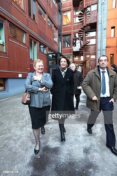 France's Health minister Marisol Touraine leaves after a visit of 'La maternite des Lilas' maternity with maternity's administrator MarieLaurence...