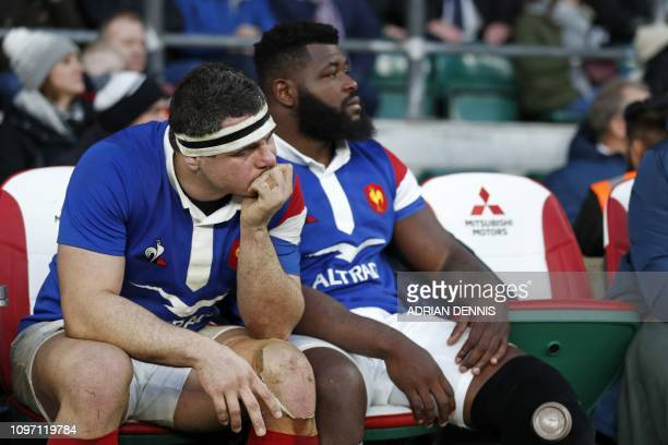 France's hooker Guilhem Guirado and France's Dany Priso react on the bench as the game enters it's final minutes during the Six Nations international...