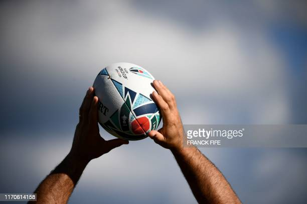 France's hooker Guilhem Guirado holds the official tournament ball during a training session at Suizenji Athletic Field in Kumamoto on September 24...