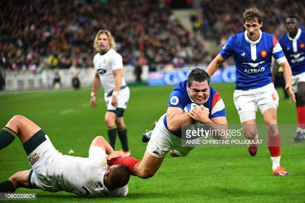 TOPSHOT France's hooker Guilhem Guirado scores a try during the international rugby union test match between France and South Africa at the Stade de...